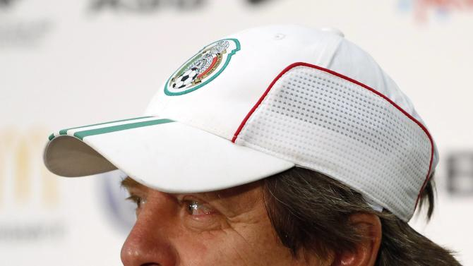Mexico's coach Herrera attends a news conference before a training session for their 2014 World Cup qualifying soccer match in Wellington