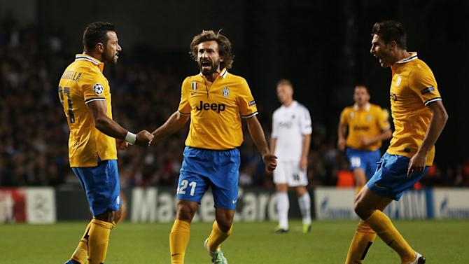 Juventus' Fabio Quagliarella, left, celebrates his equalizing goal with teammates Andrea Pirlo, center, and Federico Peluso, during their Champions League Group B soccer match against FC Copenhagen at Parken Stadium, Copenhagen, Denmark, Tuesday Sept. 17, 2013
