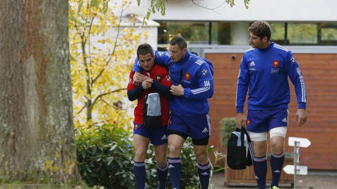France national rugby team players Wenceslas, Dulin and Pape arrive to attend a training session at the Rugby Union National Centre in Marcoussis, south of Paris
