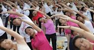 Participants exercise during Mega Yoga Day in Kuala Lumpur October 27, 2013. REUTERS/Samsul Said/Files/Files