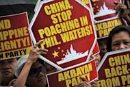 This file photo shows activists holding a protest in front of the Chinese Consular Office in Manila, last month, demanding the Chinese government to immediately pull out from Scarborough Shoal