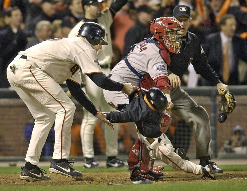 J.T. Snow drags a then 3-year-old Darren Baker out of harms way during the 2002 World Series. The son of Dusty Baker will play baseball at the University of California, Berkeley. (AP)