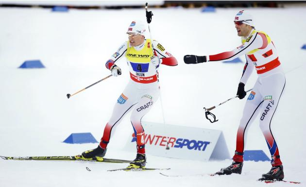 Klemetsen of Norway receives a ski pole by Moan during in the Nordic combined large hill team 2 x 7.5 km sprint event at the Nordic World Ski Championships in Falun