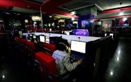 Illustration photo shows people at an Internet cafe in China. China has shut down websites, made a string of arrests and punished two popular microblogs after rumours of a coup linked to a major scandal that brought down a top politician