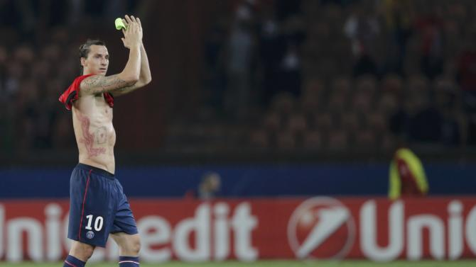 Paris Saint-Germain's Ibrahimovic celebrates after defeating Benfica in their Champions League soccer match