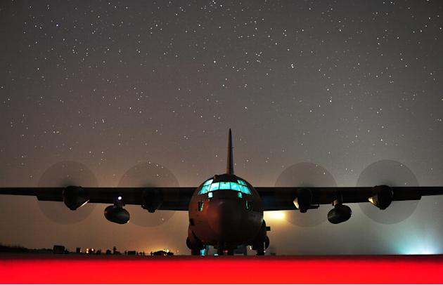 A C-130J Hercules assigned to Little Rock Air Force Base, Arkansas, performs an engine-running offload at Geronimo Landing Zone on Fort Polk, Louisiana (Tech. Sgt. Parker Gyokeres/USAF/Rex Features)