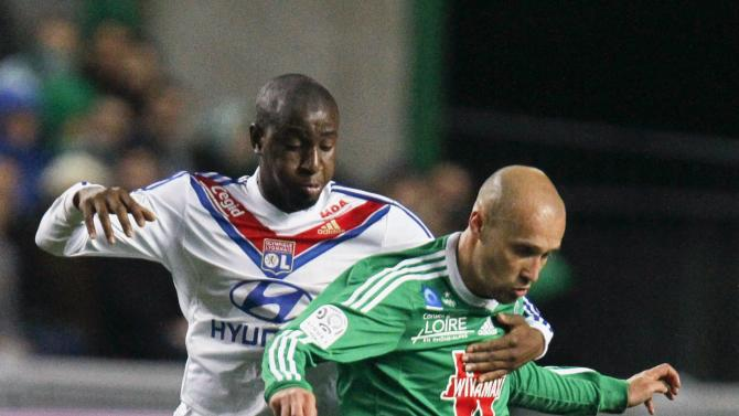 Fofana of Olympique Lyon challenges Cohade of St Etienne during their French Ligue 1 soccer match in Saint-Etienne