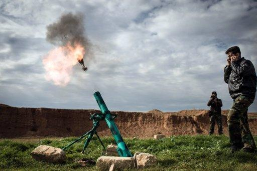 Syrian rebels fire a mortar towards regime forces stationed at Kwiriss airport in Al-Bab, 30 kilometres from the northeastern Syrian city of Aleppo on February 14, 2013. Syria's army and rebels were preparing for a major battle for control of strategic airports in Aleppo, a watchdog said, four days after insurgents launched assaults on airbases in the northern province.