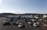 A view shows cars parked at the Izumitamatsuyu temporary housing estate, where 200 former Tomioka town residents have been evacuated to, in Iwaki, Fukushima prefecture November 8, 2013. REUTERS/Sophie Knight