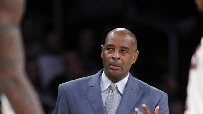 Milwaukee Bucks coach Larry Drew asks his players to the sidelines for a talk during the second half of an NBA basketball game against the Los Angeles Lakers on Tuesday, Dec. 31, 2013, in Los Angeles. The Bucks won 94-79