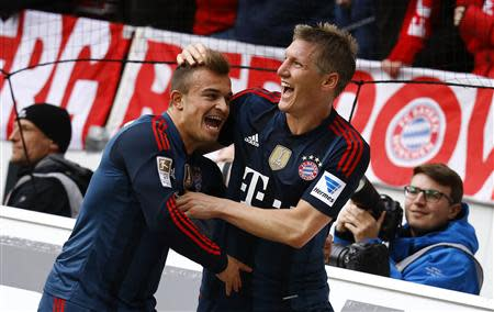 Bayern Munich's Bastian Schweinsteiger celebrates his goal with his team mate Xherdan Shaqiri during their German first division Bundesliga soccer match against FSV Mainz 05 in Mainz