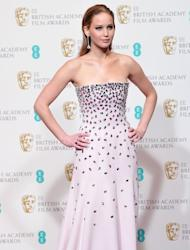 """Actress Jennifer Lawrence at the BAFTA Awards at the Royal Opera House in London on February 10, 2013. Lawrence, nominated for the best actress Oscar again this year, was first tapped in 2010 at age 20 for """"Winter's Bone"""""""