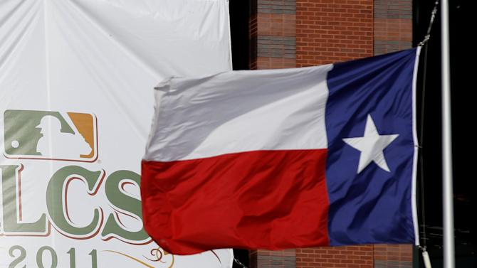 FILE PHOTO - A Texas flag flies before Game 1 of the MLB American League Championship Series baseball playoffs game in Arlington