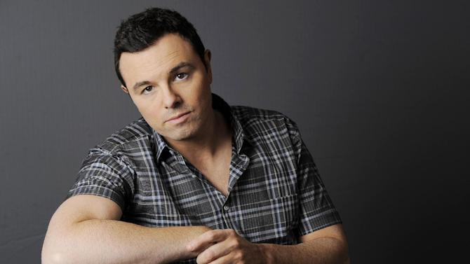 FILE - This June 16, 2012 photo shows Seth MacFarlane posing for a portrait at The Four Seasons Hotel in Beverly Hills, Calif.  Early reviews for Seth MacFarlane's Oscar-hosting skills are very positive. The Academy Awards won't be presented until Sunday, Feb. 24, 2013, but MacFarlane won laughs from the show's director during a rehearsal Thursday, Feb. 21,  inside the Dolby Theatre. (Photo by Chris Pizzello/Invision/AP)