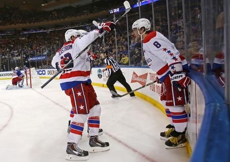 May 2, 2015; New York, NY, USA; Washington Capitals left wing Alex Ovechkin (8) celebrates with teammates after scoring a goal on New York Rangers goalie Henrik Lundqvist (30) during the third period in game two of the second round of the 2015 Stanley Cup Playoffs at Madison Square Garden. Adam Hunger-USA TODAY Sports