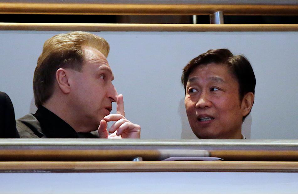 Russian First Deputy Prime Minister Igor Shuvalov, left, speaks with China's Vice President Li Yuanchao, right, during a state funeral of the late Lee Kuan Yew, held at the University Cultural Center,