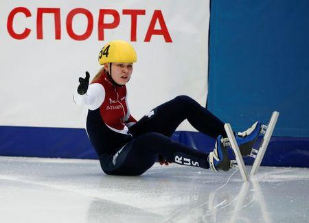 Konstantinova of Russia  falls as she competes during women's 3000m relay semifinals at ISU World Short Track Speed Skating Championships in Moscow
