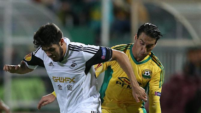 Swansea City's Alejandro Pozuelo, left, vies for a ball with Kuban Krasnodar's Ivelin Popov during their Europa League group A soccer match at a stadium in Krasnodar, Russia, Thursday, Nov. 7 2013
