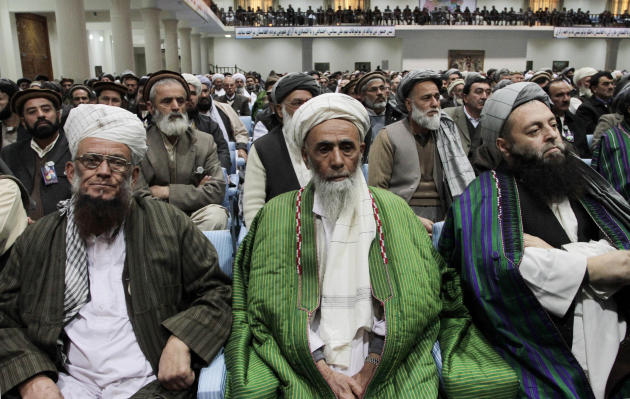 "Participants listen to Afghan President Hamid Karzai, not seen, deliver a speech during the opening of the ""loya jirga,"" or grand council in Kabul, Afghanistan, Wednesday, Nov. 16, 2011. Afghan Presid"