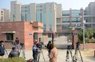"""Indian media wait outside the district court Saket in New Delhi on January 5, 2013. The father of the New Delhi gang-rape victim has revealed his daughter's identity to a British newspaper and called for her name to be made public """"to give courage to other women"""" in an interview published Sunday"""