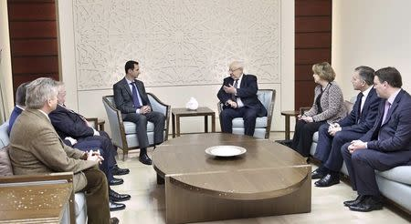 Syria's President Bashar al-Assad meets with a French delegation headed by Senate member, Head of the Senate's French-Syrian Friendship Committee Jean-Pierre Vial,in Damascus