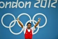 Kim Myong Hyok of Democratic People's Republic of Korea competes in the men's weightlifting 69kg group at the Olympic Games. North Korea has extended its television coverage of the Olympics to an unusual five hours a day, but many people are still unable to watch due to serious power shortages, a report said