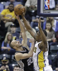 San Antonio Spurs' Manu Ginobili has his shoot blocked by Indiana Pacers' Kevin Seraphin during the first half of an NBA basketball game Monday, Feb. 13, 2017, in Indianapolis. (AP Photo/Darron Cummings)