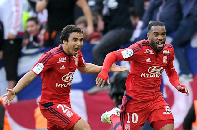 Lyon, whose leading scorer Alexandre Lacazette, right, has this week been linked with a move to Barcelona, will look to defend their unbeaten record  when they host Gazelec