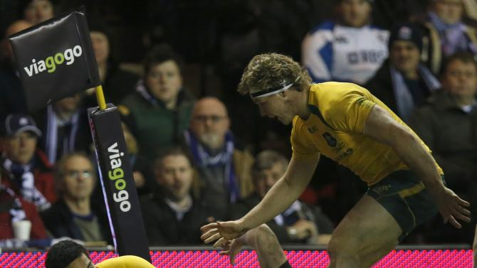 Australia's Feauai-Sautia scores a try against Scotland during their rugby union international test match in Edinburgh