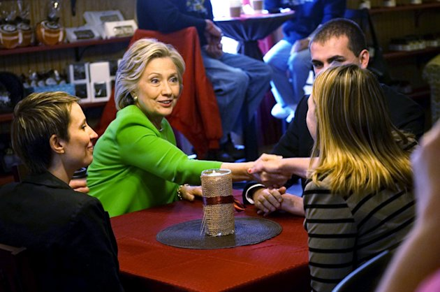 Hillary Clinton talks with local residents as she campaigns in LeClaire, Iowa on April 14, 2015. REUTERS/Rick Wilking