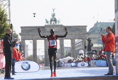 Silver medalist Kipsang of Kenya celebrates at the Berlin marathon in Berlin