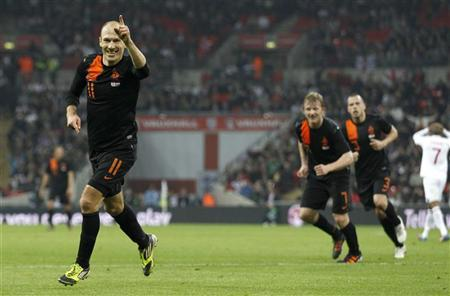 Holland's Arjen Robben celebrates scoring the winning goal during their international friendly match against England at Wembley Stadium in London