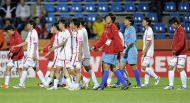 In this photo made available on Thursday, July 7, 2011 North Korea's players leave the pitch for a doping test after the group C match against Colombia at the Women's Soccer World Cup in Bochum, Germany, Wednesday, July 6, 2011. The whole team had to do the doping test after the match due to two players that have been tested positiv before. (AP Photo/Martin Meissner)