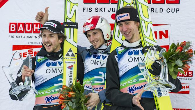 Winner Slovenia's Robert Kranjec (C), second-placed Switzerland's Simon Aman (L) and third-placed Austria's Martin Koch (R) pose after the FIS Ski Flying World Cup in Planica on March 16, 2012.  AFP PHOTO / Jure Makovec (Photo credit should read Jure Makovec/AFP/Getty Images)