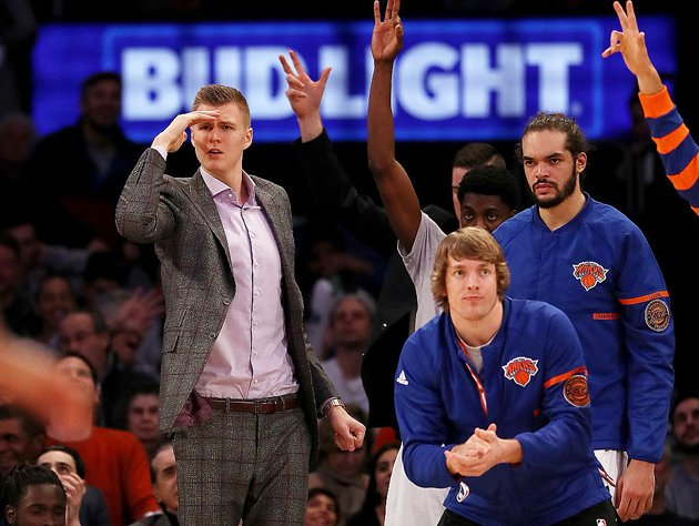 Kristaps Porzingis and the view from the bench. (Getty Images)