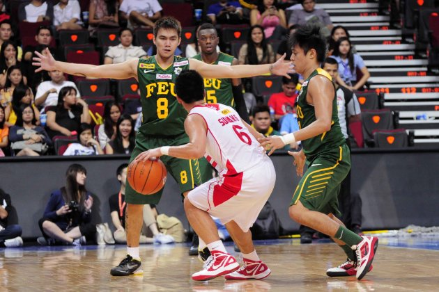 RR Garcia and Terrence Romeo gang up on Roi Sumang. (NPPA)