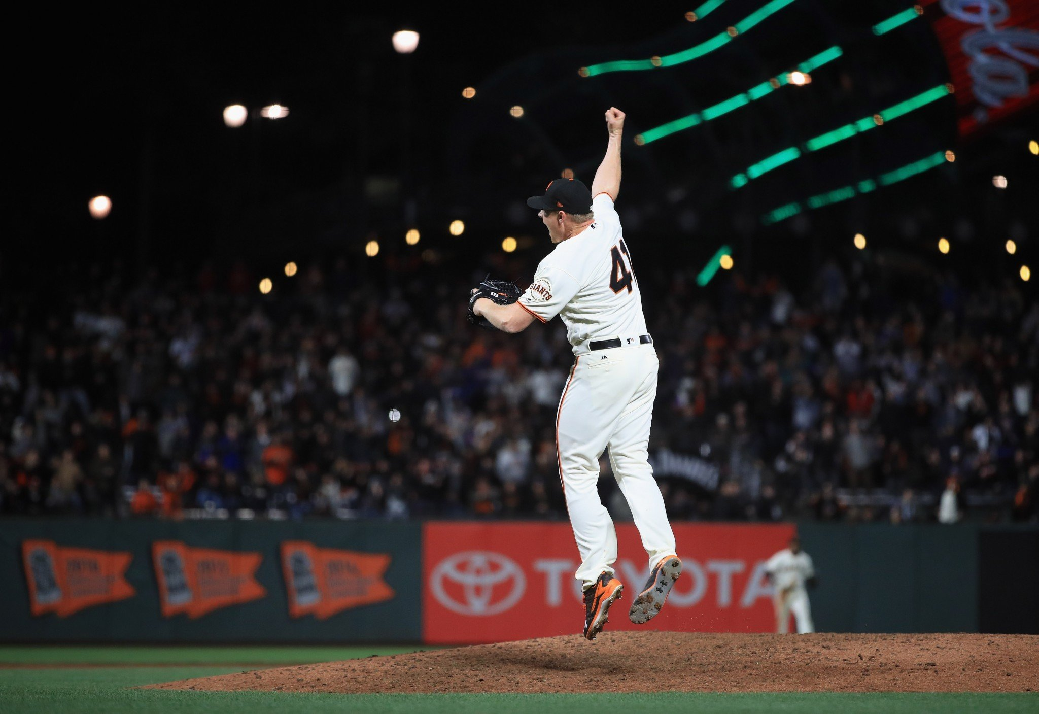 Giants closer Mark Melancon jumps for joy after the final out. (Getty Images)