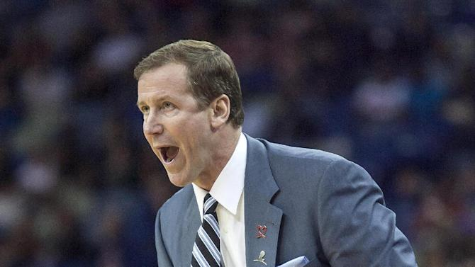 Portland Trail Blazers head coach Terry Stotts yells to his players in the second half against the New Orleans Pelicans during an NBA basketball game in New Orleans, Friday, March 14, 2014. The Trail Blazers won 111-103