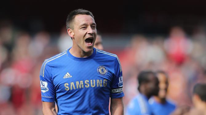 Chelsea's John Terry celebrates victory after the final whistle against Arsenal