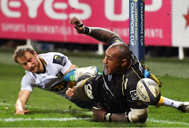 Montpellier's Fijian winger Nemani Nadolo (R) reacts after scoring a try  during the European Rugby Union Champions Cup match between Castres and Leinster on January 20, 2017 at the Pierre Antoine