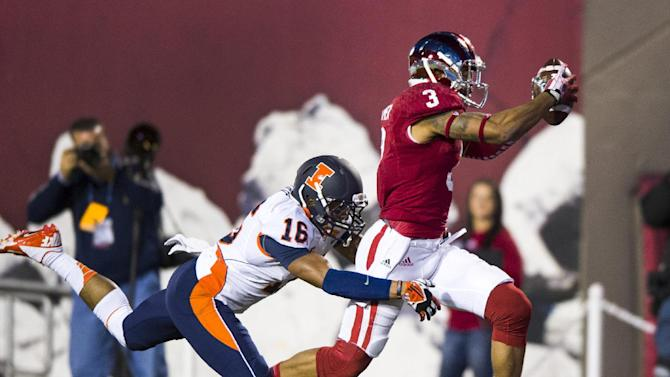 Indiana's Cody Latimer (3) runs into the end zone to score as Illinois' Caleb Day (16) reaches out in an effort to pull him down during the second half of an NCAA college football game, Saturday, Nov. 9, 2013, in Bloomington, Ind. Indiana won 52-35