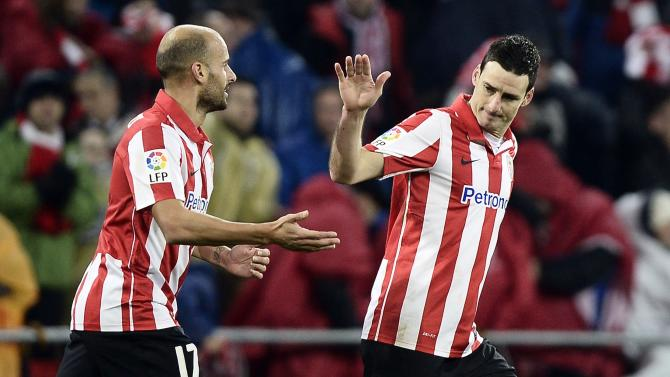 Athletic Bilbao's Aritz Aduriz celebrates his goal with teammate Mikel Rico during their Spanish King's Cup match against Atletico Madrid at San Mames stadium in Bilbao