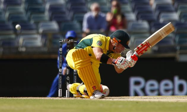 Australia's batsman David Warner misses sweeping the ball during a delivery from Afghanistan during their Cricket World Cup match in Perth