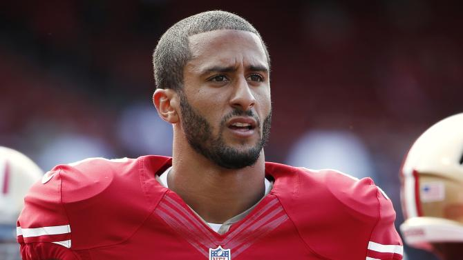 File photo of San Francisco 49ers' Kaepernick standing on the field before their NFL pre-season football game against Denver Broncos in San Francisco