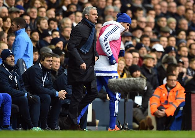 Chelsea's Diego Costa (R) passes manager Jose Mourinho during the English Premier League football match against Tottenham Hotspur, at White Hart Lane in London, on November 29, 2015
