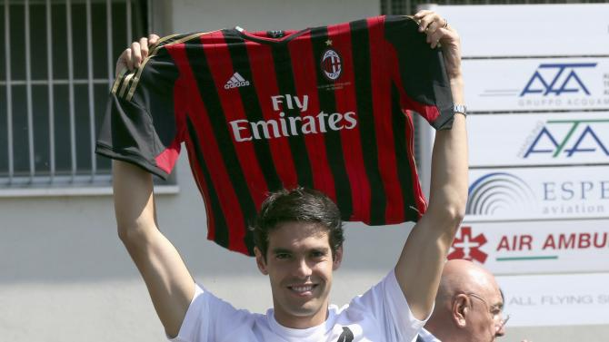 Brazilian player Kaka holds up an AC Milan jersey after arriving in a private jet in Milan