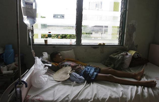 In this photo taken Thursday, June 9, 2011, a Filipino boy lies on his bed at the pedia dengue ward at San Lazaro Hospital in Manila, Philippines. ASEAN health ministers have designated Wednesday, June 15 as ASEAN Dengue Day in a bid to raise public awareness on dengue prevention and control at the regional and national level. (AP Photo/Aaron Favila)