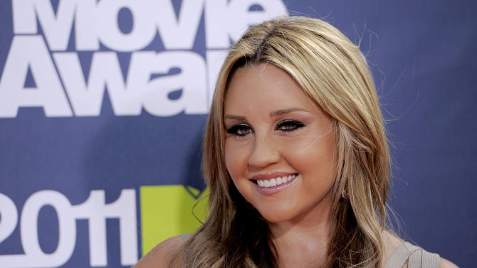 FILE - In this June 5, 2011 file photo, Amanda Bynes arrives at the MTV Movie Awards, in Los Angeles. Bynes is due in court Tuesday July 9, 2013 on allegations that she tossed a marijuana bong from the window of her 36th floor Manhattan apartment. The 27-year-old actress is charged with reckless endangerment and attempted tampering with physical evidence. (AP Photo/Chris Pizzello, File)
