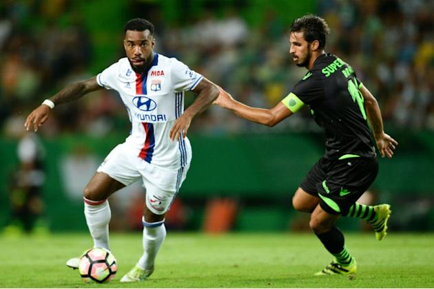 Olympique Lyon's forward Alexandre Lacazette (left) vies with Sporting's Costa Rican forward Bryan Ruiz during a friendly match at the Jose Alvalade stadium in Lisbon on July 23, 2016