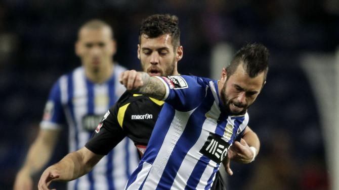 Porto's Defour battles for the ball with Arouca's Simao during their Portuguese Premier League soccer match in Porto